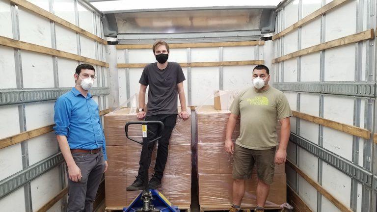 Three Manta Biofuel employees wearing masks