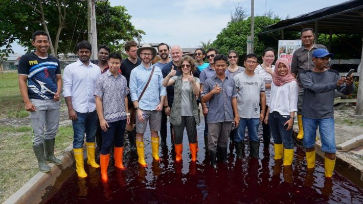 REEF Fellow Suzan Shahrestani poses with a group at a shrimp farm